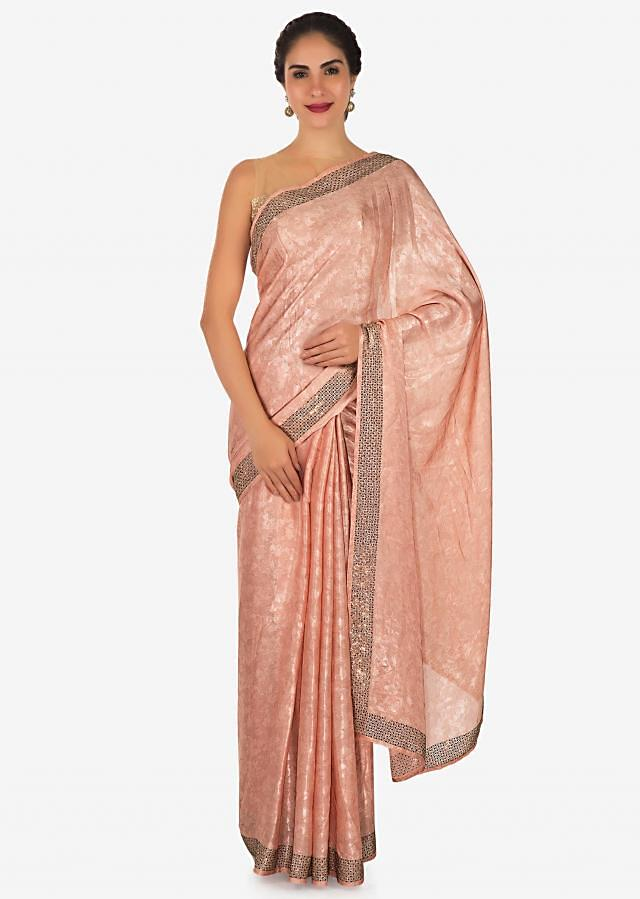 Shimmer pink saree adorn in kundan and thread work only on Kalki