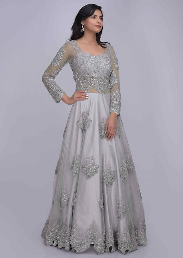 Silver grey ethnic gown in embroidered net fabric with back trail only on Kalki
