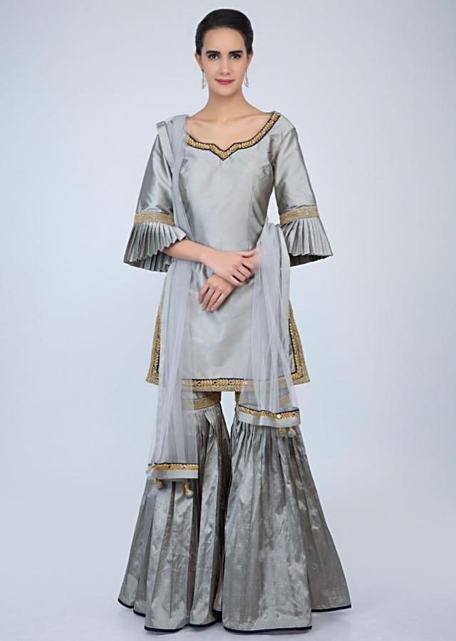 Silver grey satin silk sharara suit with embroidered edges only on Kalki