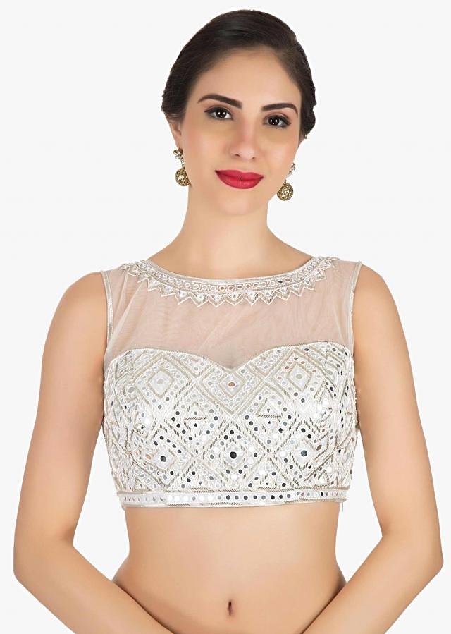 Silver blouse in fancy fabric showcasing the beautiful mirror work only on Kalki