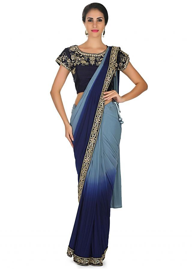 Sky blue and navy blue pre stitched saree with coral ready embroidered blouse only on Kalki