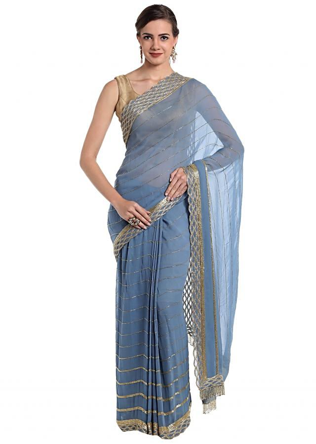Sky blue georgette saree featuring cut dana border  only on Kalki