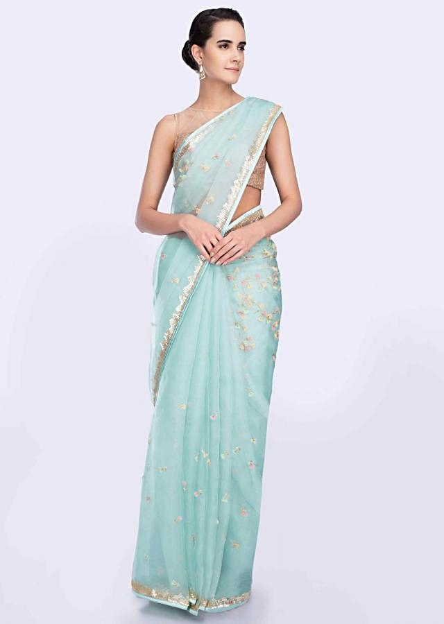 Sky blue organza saree beautified with 3D flower and applique work only on Kalki