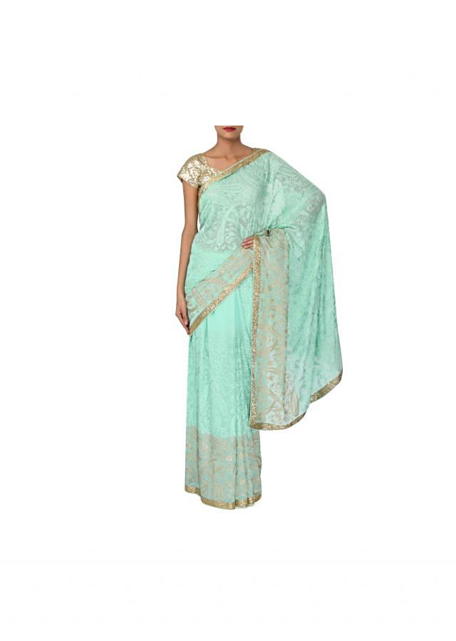 Sky blue saree embellished in paisley motif embroidery only on Kalki
