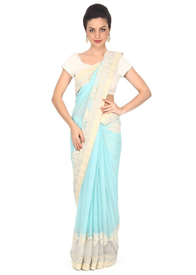 Sky blue shimmer saree enhanced in embroidered butti only on Kalki
