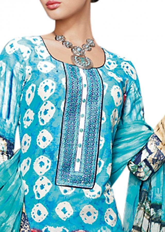 Sky blue unstitched suit enhanced in resham and print