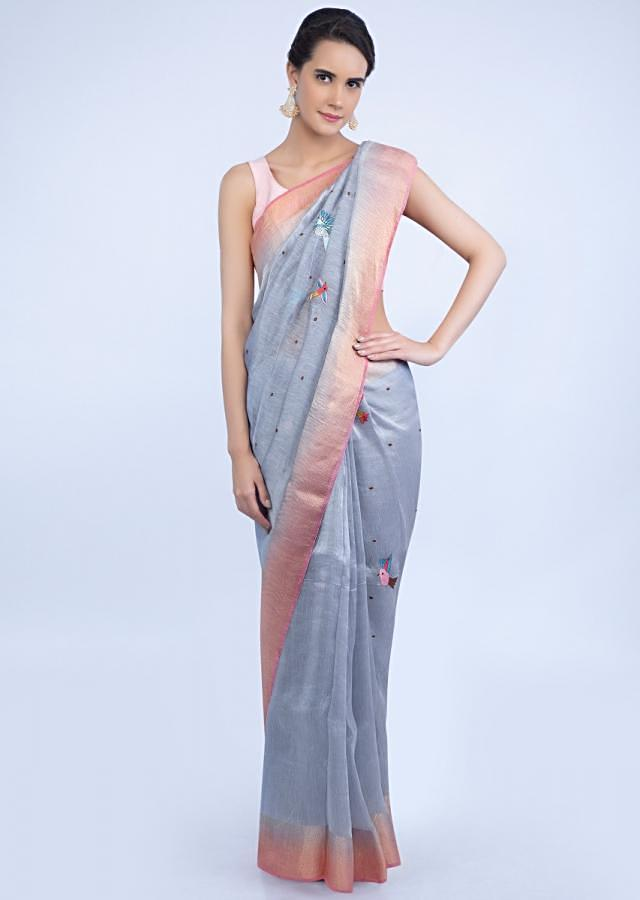 Slate blue linen saree with bird and scenery embroidery only on Kalki