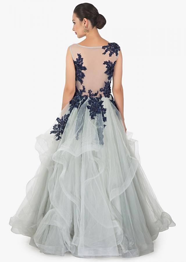 Sleveless smoke grey net gown with knife pleated layered look complimented with black navi blue floral bodice  only on kalki