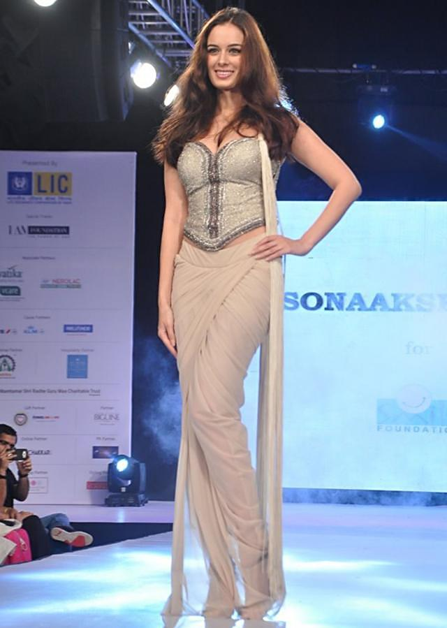 Evelyn Sharma walks the ramp in beige saree gown with embellished blouse for Sonaakshi Raak for Smile Foundation