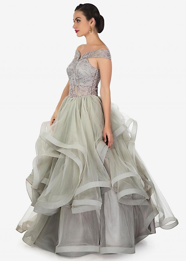 Stone grey layered gown in off shoulder embroidered bodice only on Kalki