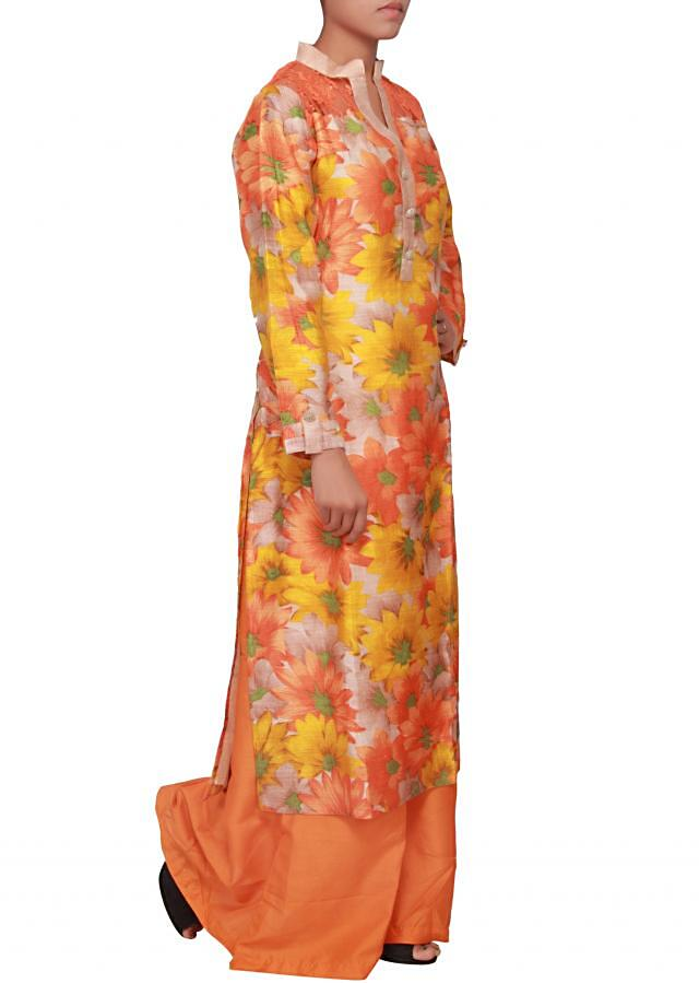 Featuring a multi coloured floral print raw silk straight fit suit only on Kalki