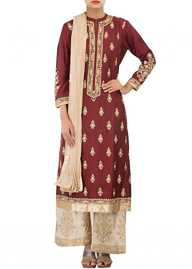 Straight fit suit in maroon adorn in zari embroidery only on Kalki