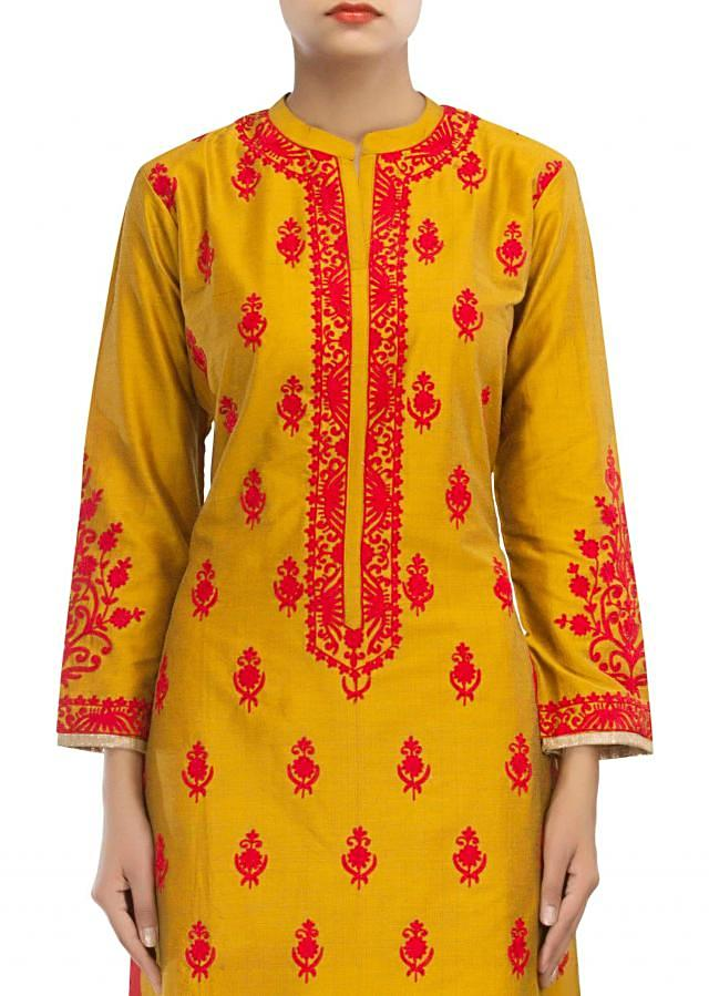 Straight fit suit in mustard adorn in zari embroidery only on Kalki