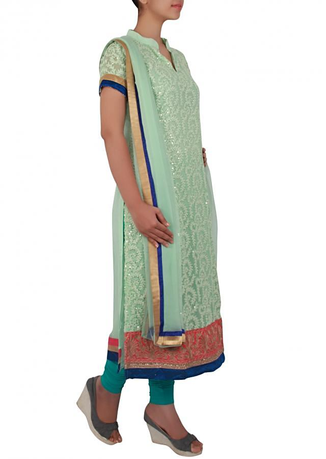 Straight fit suit in pista green embellished in thread work only on Kalki