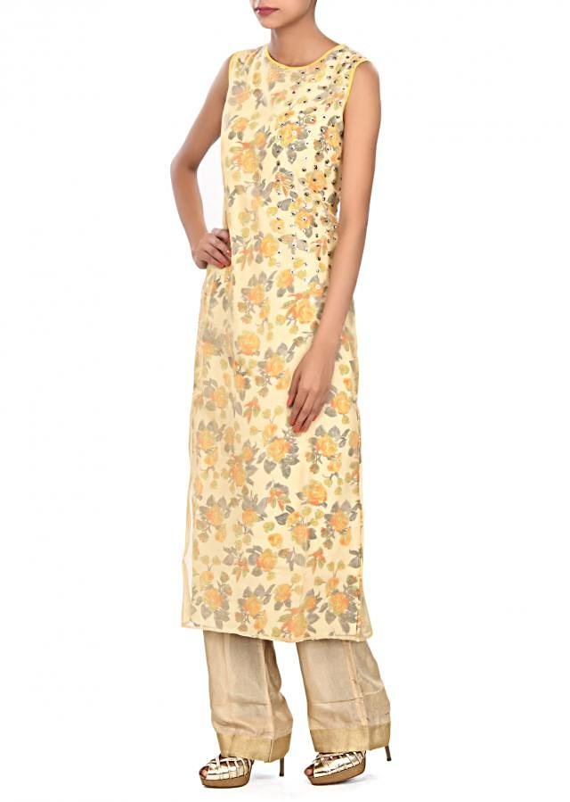 Straight suit embellished in press buttons only on Kalki