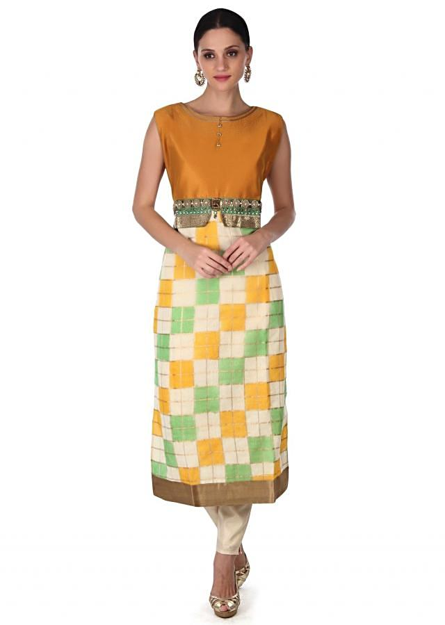 Straight suit features in silk with embroidered waist line only on Kalki