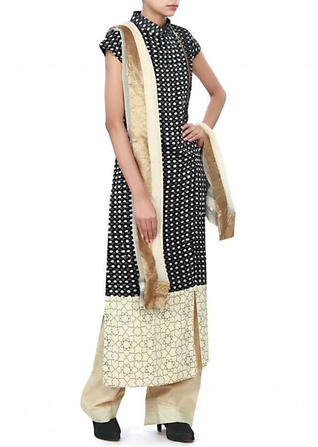 Straight suit featuring in black printed cotton. only on Kalki