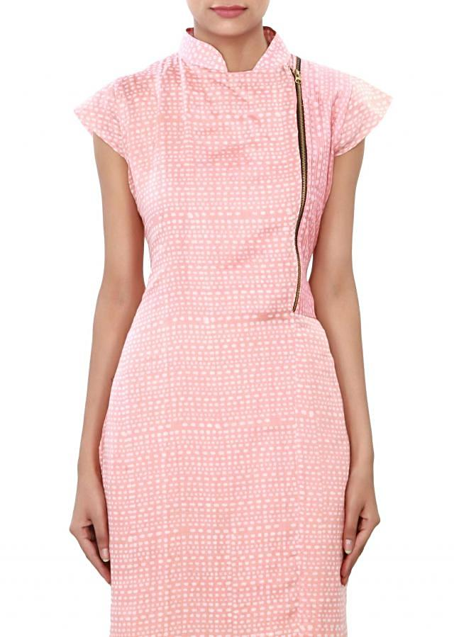 Straight suit featuring in pink printed cotton. only on Kalki
