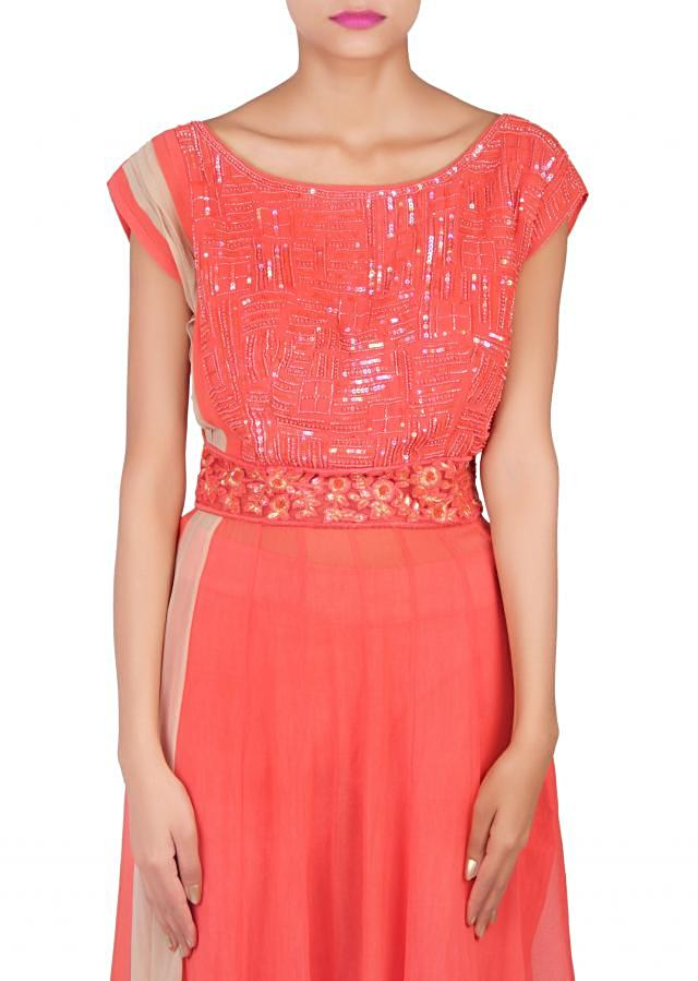 Straight suit in orange adorn in sequence only on Kalki