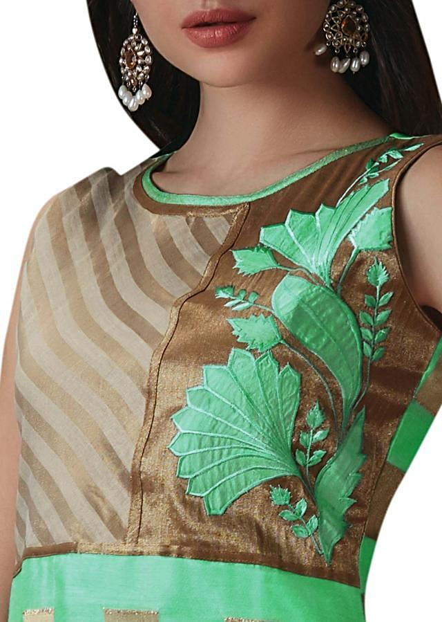 Straight suit in pista green with applique work