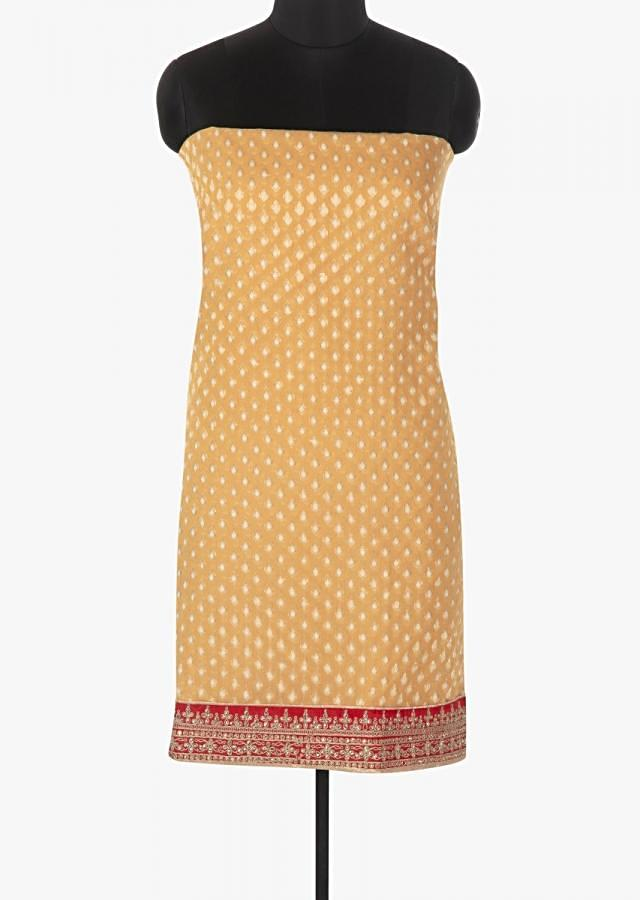 Sun yellow unstitched suit in brocade silk. Hem line is embellished in kundan and zari embroidery only on kalki