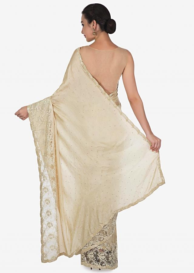Tan cream saree with Chantilly lace and kundan embroidery only on Kalki