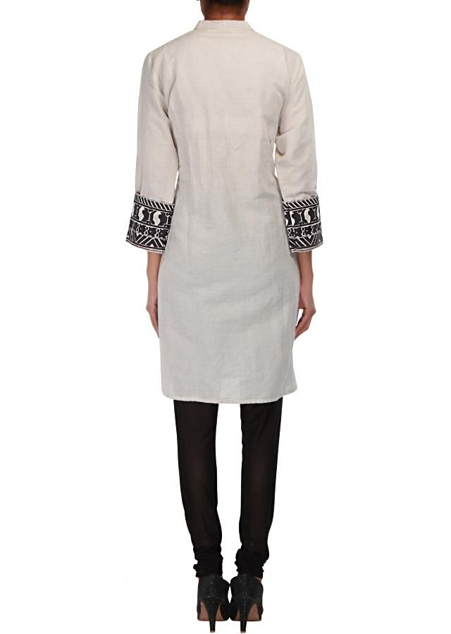 Taupe cotton kurti embellished in resham embroidery only on Kalki