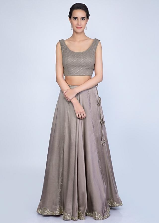 Taupe lehenga and blouse with matching embroidered net dupatta and a fancy jacket only on Kalki