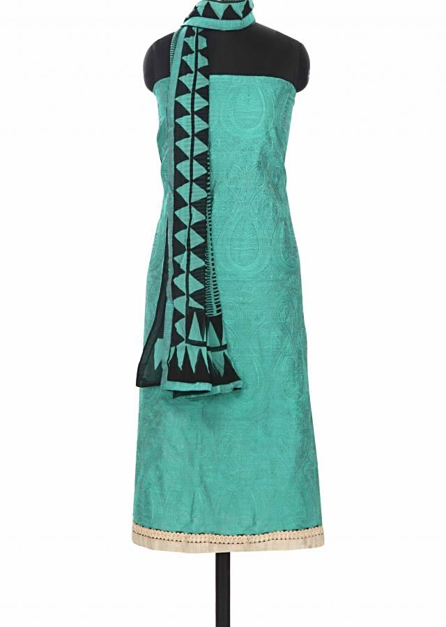 Teal blue unstitched suit in paisley motif only on Kalki
