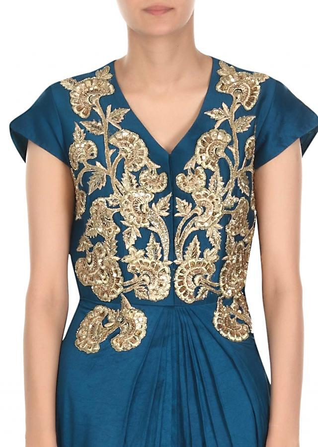 Teal green anarkali suit adorn in zari and sequin embroidery only on Kalki