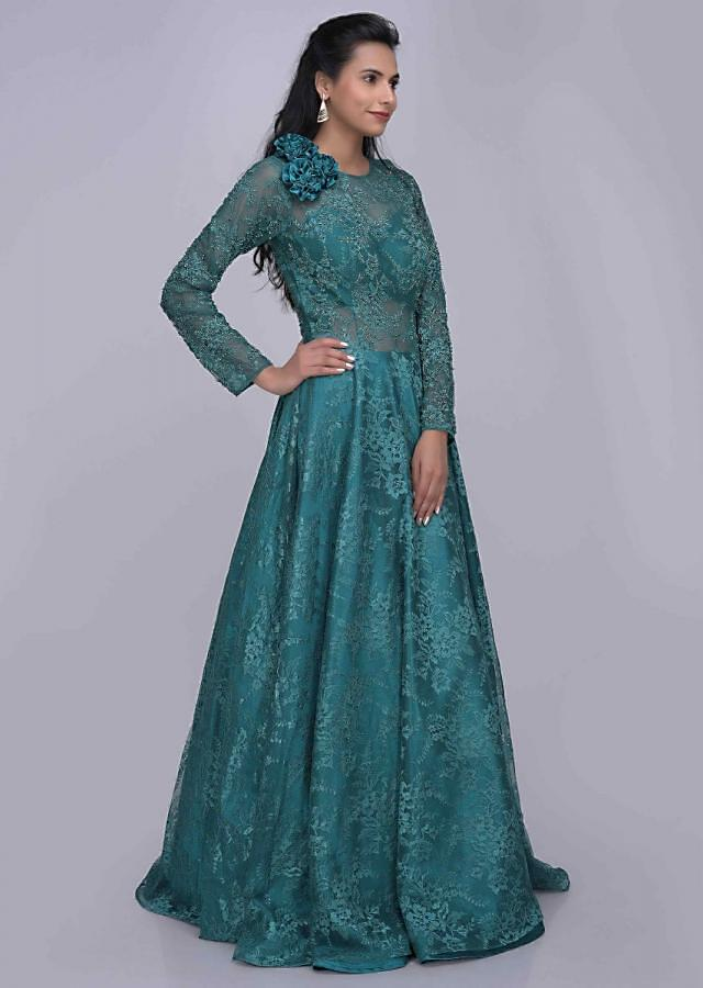 Teal green ethnic gown in fancy floral lace fabric only on Kalki