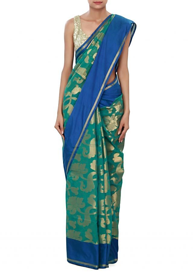 Teal green saree featuring in weave embroidery only on Kalki