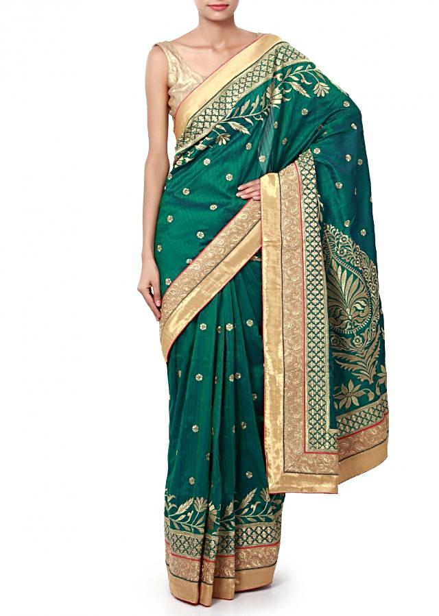 Teal saree featuring in weave embroidery only on Kalki