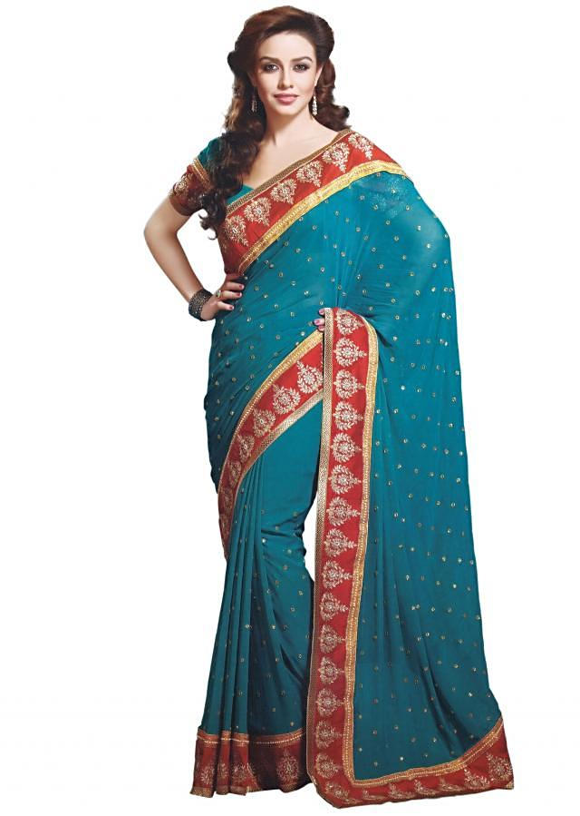 Teal saree with embroidered border