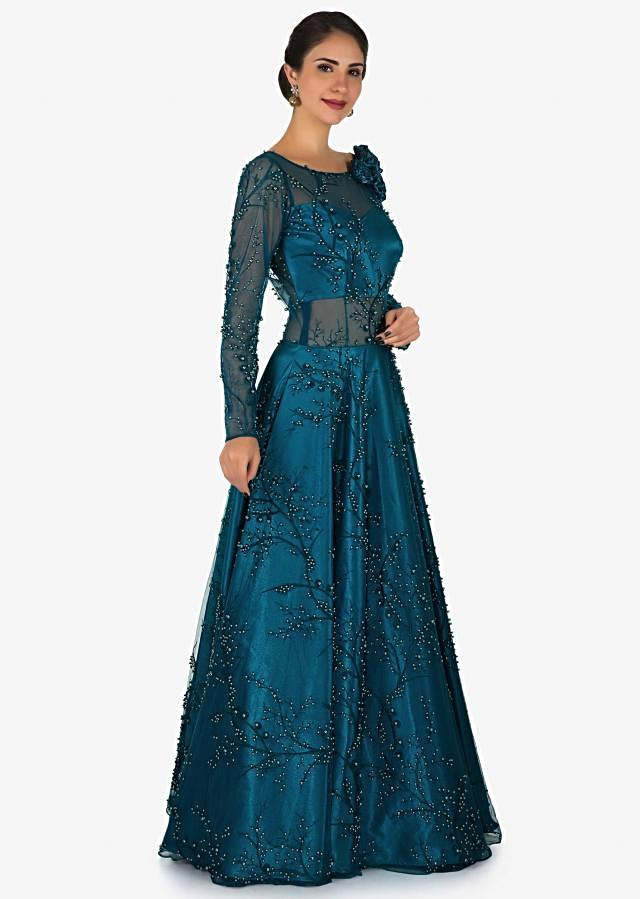 Teal blue gown in net enhanced in moti and resham embroidery work only on Kalki