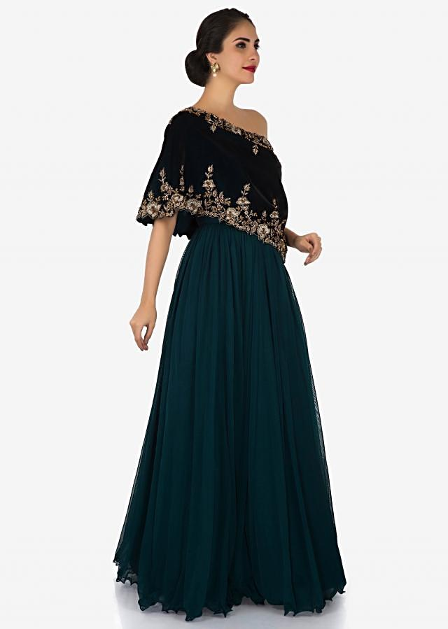 Teal Blue net gown beautified with zardosi and moti embroidery work only on Kalki