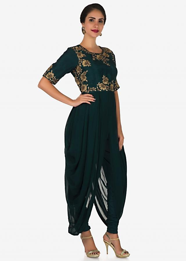 Teal blue suit adorn in zari and zardosi embroidery work only on Kalki