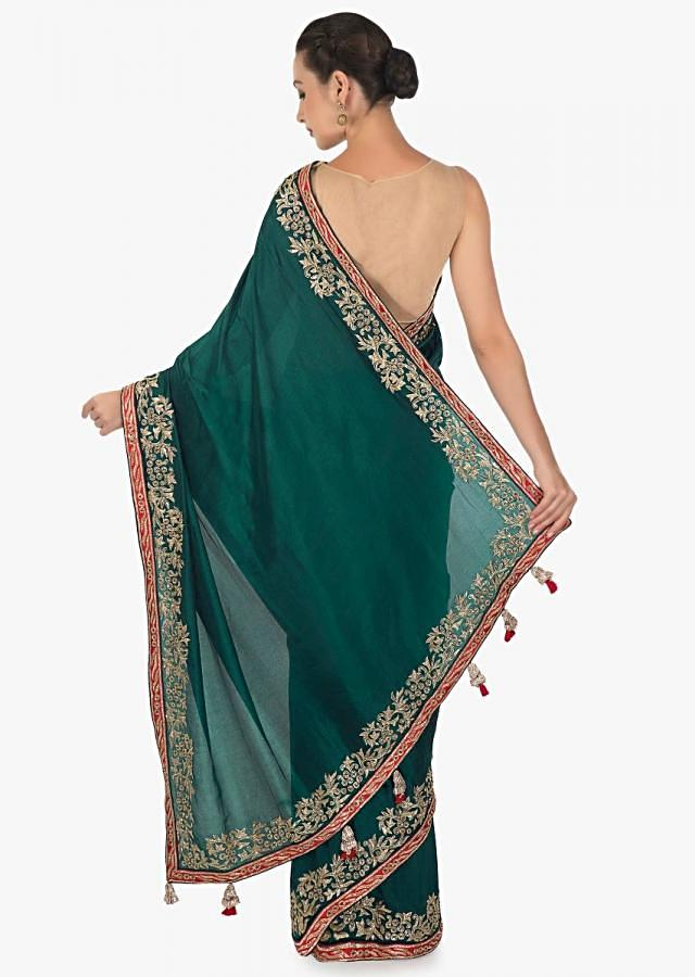 Teal green saree in santoon with zari and cut dana embroidered border only on Kalki