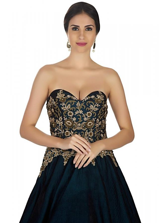 The corset cocktail gown in bottle green adorned with sequins and floral embroidery only on Kalki