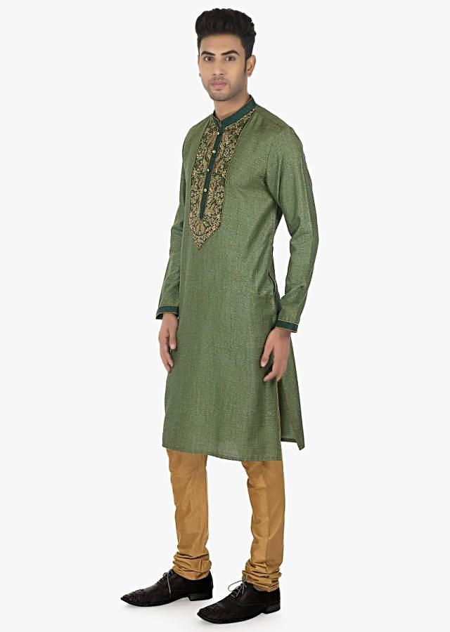 Thyme Green  silk kurta with a contrasting collar and sleeves matched with a Sandal brown  chudidar set only on Kalki