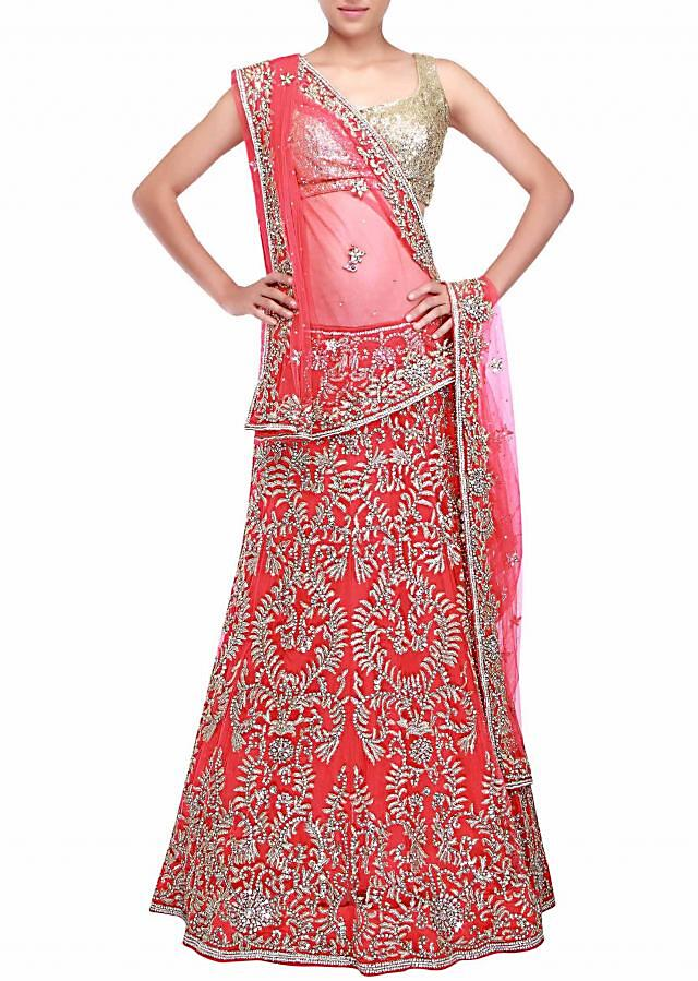 Tomato red unstitched lehenga adorn in pearl and kundan embroidery only on Kalki