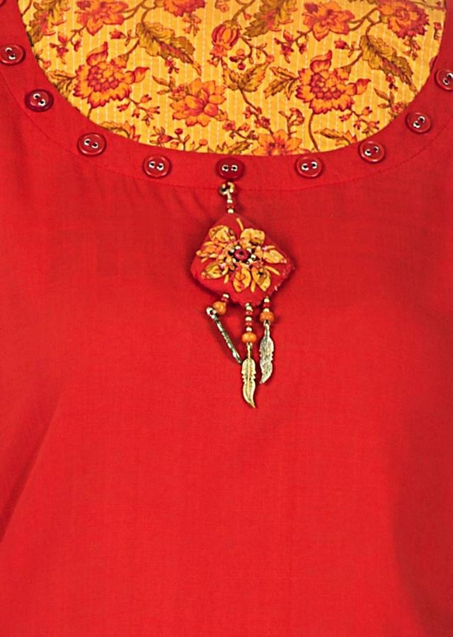 Tomato Red Kurti With Fancy Neckline In Buttons And Tassel Online - Kalki Fashion