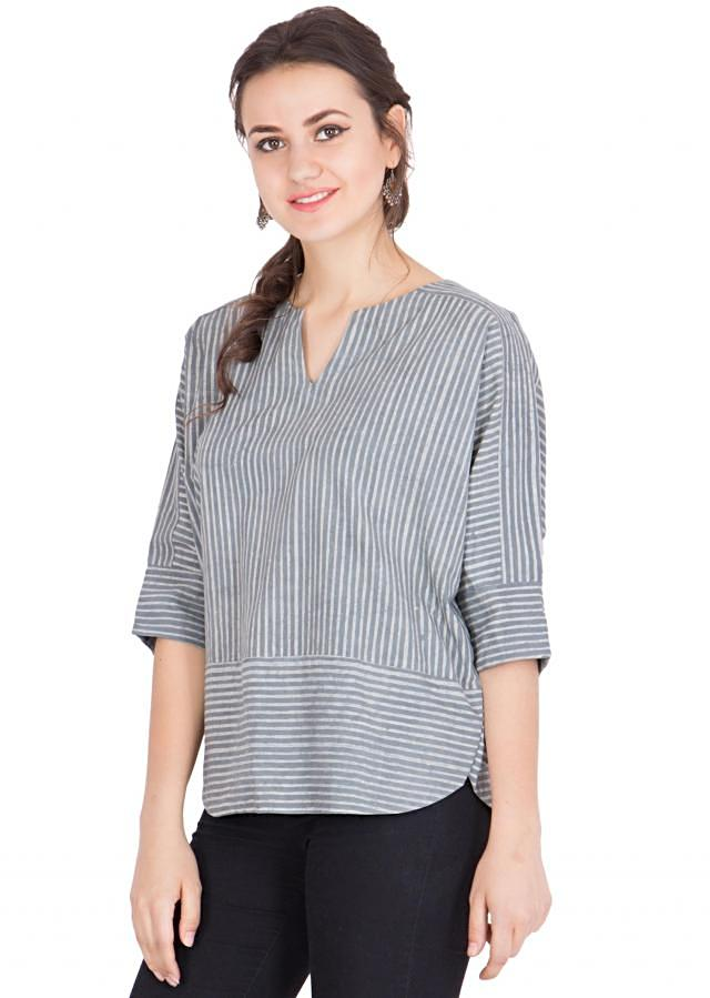 Top with round notched neck style and three quarter batwing sleeves