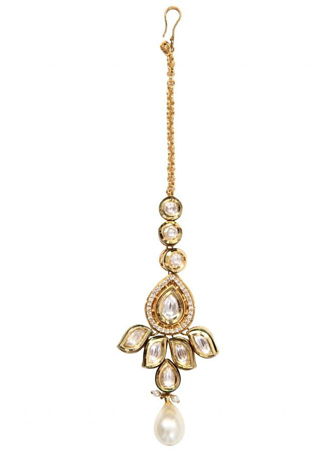 traditional gold kundan maang tikka with gold enamel and a pearl drop