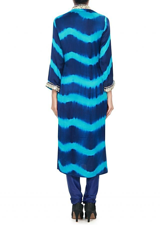 Turq and navy blue kurti adorn in mirror and fancy buttons only on Kalki