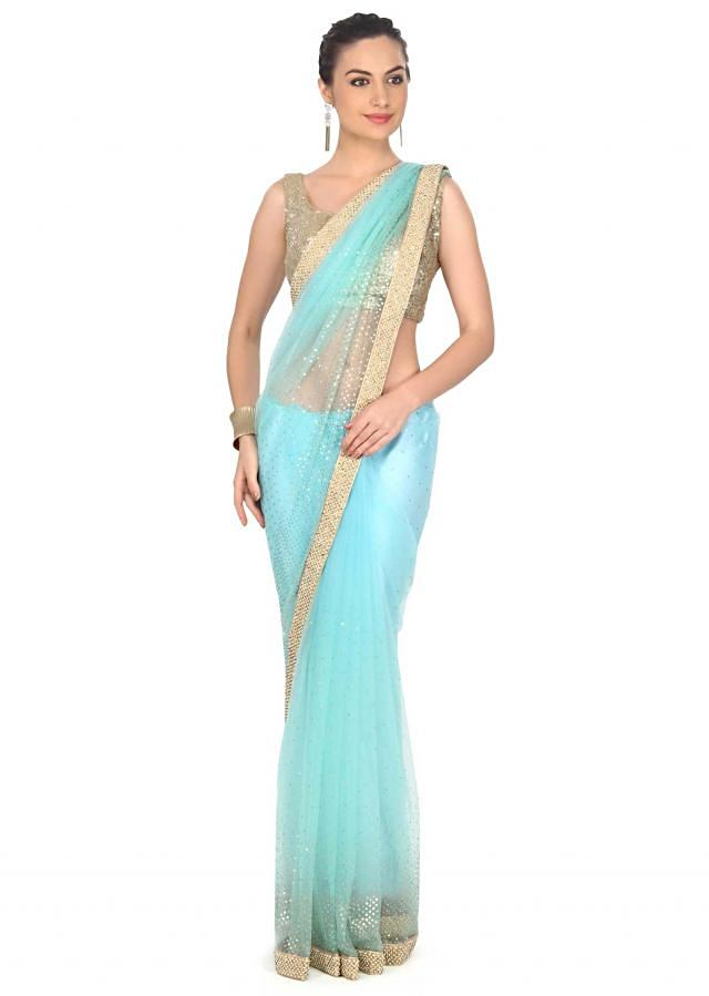 Turq and ice green saree adorn in sequin and kardana work only on Kalki