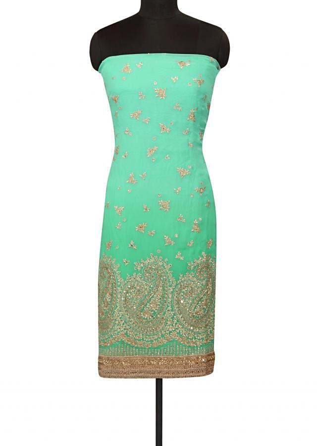 Turq and sea green unstitched suit in zari embroidery only on Kalki