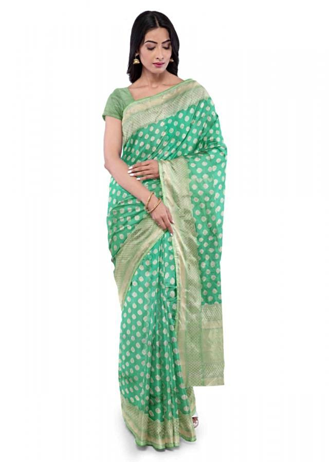 Turq banarasi silk saree with matching blouse piece only on Kalki
