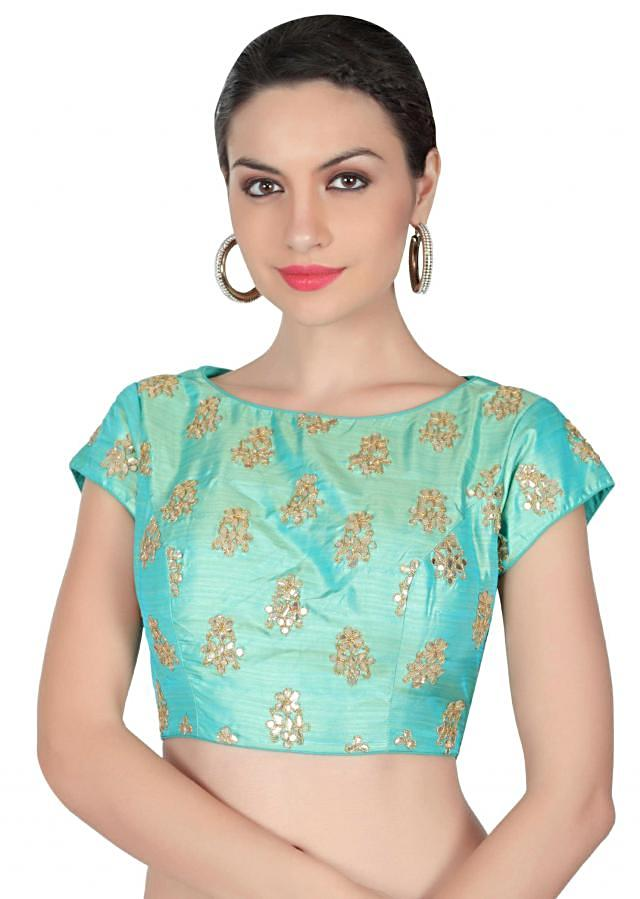 Turq blouse adorn in gotta patch work only on Kalki