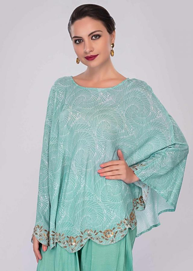 Turq blue dhoti pant paired with cape top in print and scallop border only on Kalki